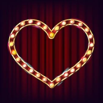 Marco de corazón dorado con bombillas incandescentes