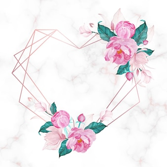 Marco de corazón de oro rosa con flores sobre fondo de mármol.