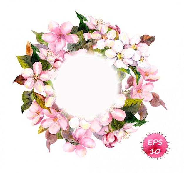 Marco de corona con cereza, manzana, flores de almendra, sakura.