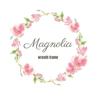 Marco de corona de flores y ramas de magnolia floreciente rosa acuarela