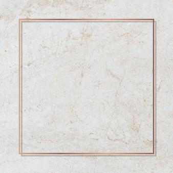 Marco cuadrado dorado en un vector de mármol