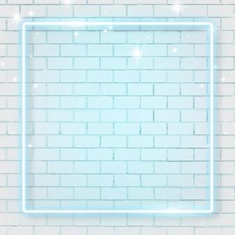 Marco cuadrado de neón azul sobre fondo de pared de ladrillo