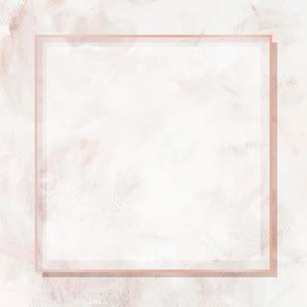 Marco cuadrado de oro rosa sobre fondo de mármol beige
