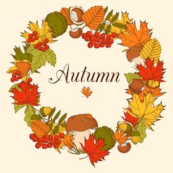 Marco decorativo hecho en forma de ornamento que incluye elementos de árboles forestales de otoño