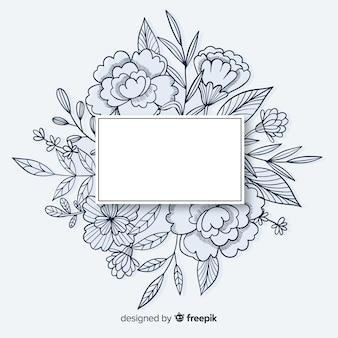 Marco dibujado a mano con diseño floral y espacio de copia