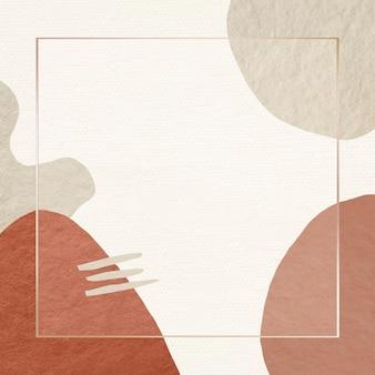 Marco dorado en patrón abstracto de tono tierra