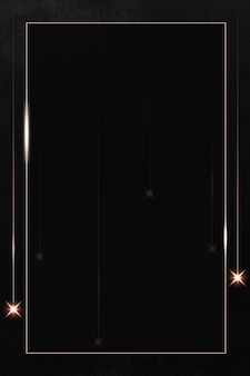 Marco dorado rectangular con destellos estampados sobre fondo negro