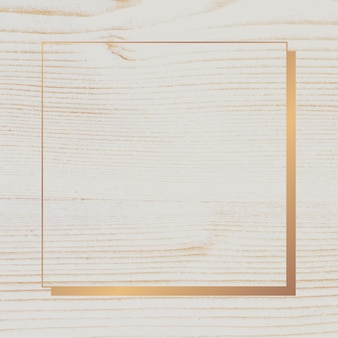 Marco dorado sobre fondo de madera beige