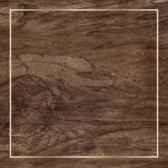Marco dorado sobre fondo de madera
