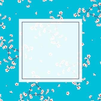 Marco de flor de melocotón blanco sobre fondo azul añil