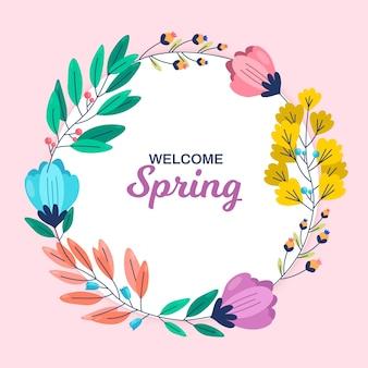 Marco floral de primavera con coloridas flores y hojas sobre fondo rosa
