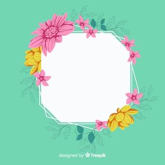 Marco floral de primavera en diseño plano