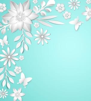 Marco con flores de papel blanco sobre fondo azul.