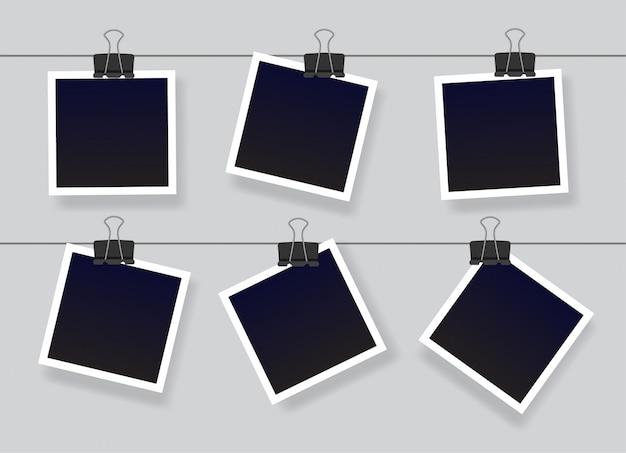 Marco de foto instantánea en blanco conjunto colgado de un clip. plantillas de marcos de fotos vintage vacías negras. ilustración aislada sobre fondo gris.