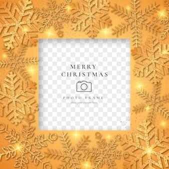 Marco de fotos de navidad dorado con copos de nieve brillantes
