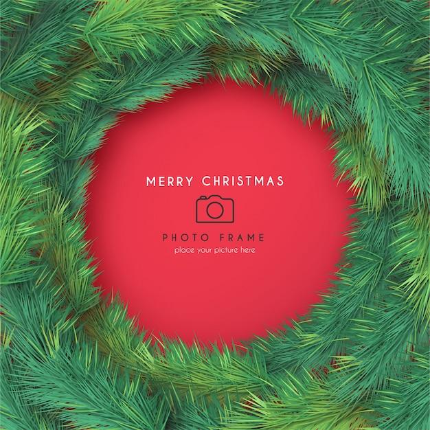 Marco de fotos de navidad con ramas realistas