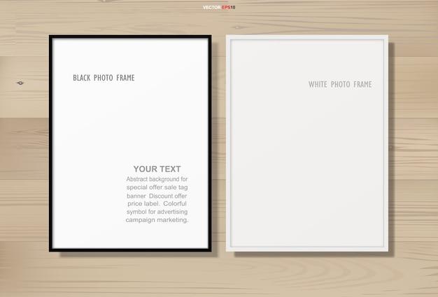 Marco de fotos o marco de fotos sobre fondo de textura de madera