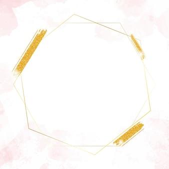 Marco hexagonal dorado brillo en salpicaduras de acuarela