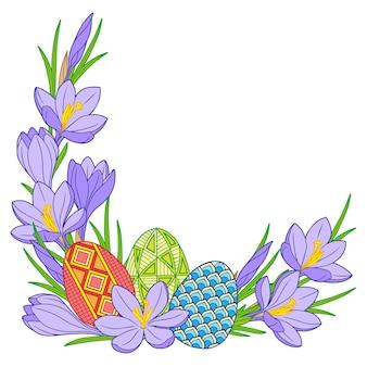 Marco de huevos de pascua brillantes y flores de azafrán
