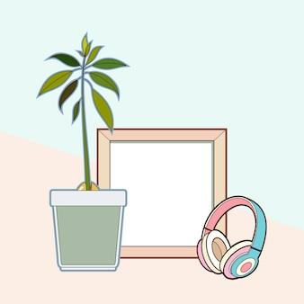 Marco de madera, auriculares, planta de aguacate.