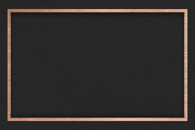 Marco de madera sobre fondo de textura de tela negra