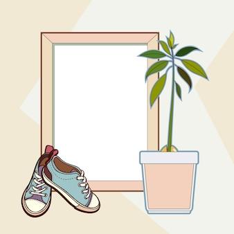 Marco de madera, zapatillas y planta de aguacate.