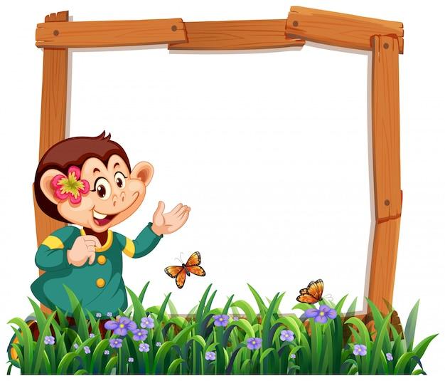 Marco de mono en la naturaleza con hierba y mariposas