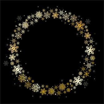 Marco redondo de copos de nieve dorados sobre fondo negro.
