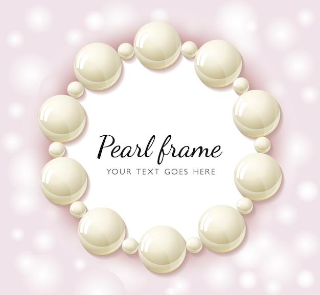Marco redondo de perlas sobre fondo rosa bokeh.