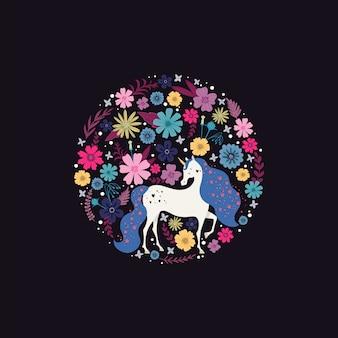 Marco redondo con un unicornio rodeado de flores.