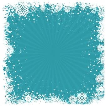 Marco retro de copos de nieve en un fondo azul