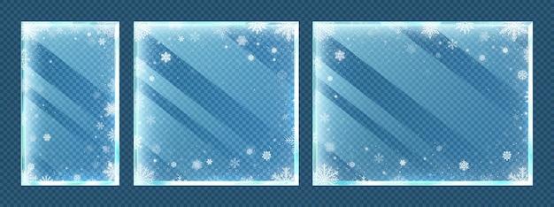 Marcos de vidrio congelado con copos de nieve