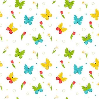Mariposas de colores brillantes, tulipanes rojos y narcisos de patrones sin fisuras sobre fondo blanco