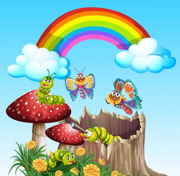 Mariposas y gusanos que viven en la escena del jardín durante el día con arco iris.