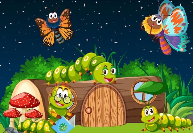 Mariposas y gusanos que viven en la escena del jardín por la noche.