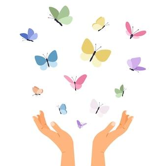 Mariposas volando de manos abiertas.