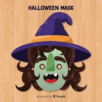 Máscara de bruja de halloween en diseño plano
