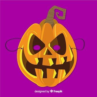 Máscara de calabaza de halloween en diseño plano