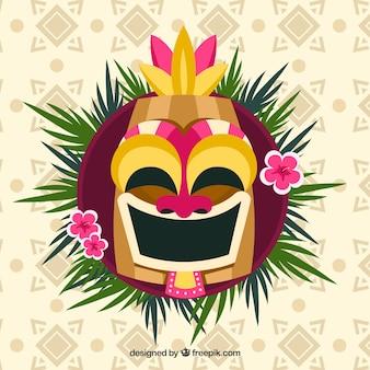 Máscara tiki sonriente con hojas de palmera y flores
