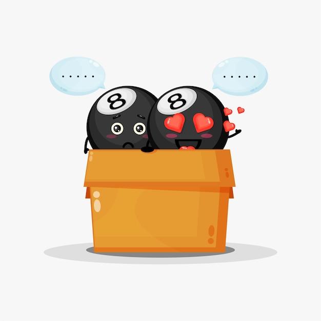 Mascota linda bola de billar en la caja