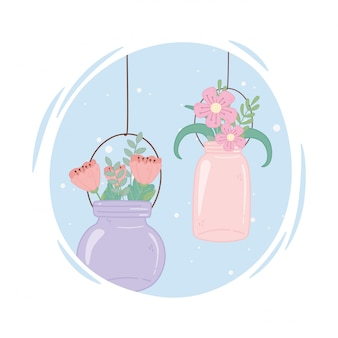 Mason frascos de vidrio con flores colgando
