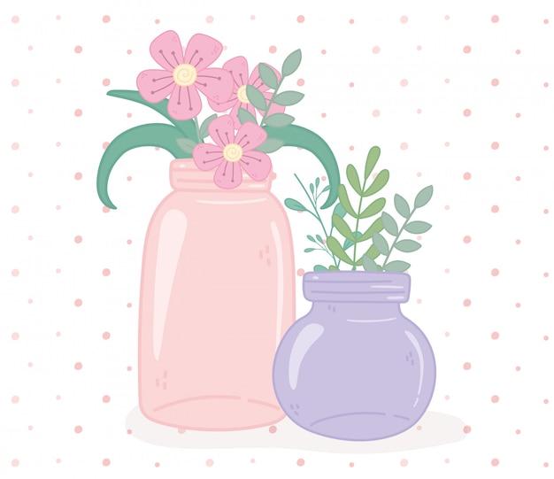 Mason frascos de vidrio con fowers y hojas