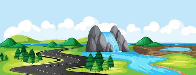 Meadow park y road con escena de paisaje de lado del río de caída de agua