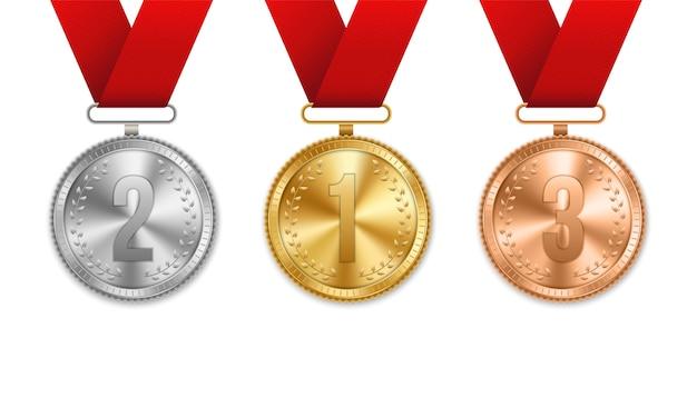 Medalla de oro, plata y bronce con conjunto de cintas.