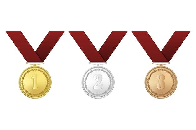 Medallas de oro, plata y bronce con cintas rojas sobre fondo blanco. el primer, segundo, tercer premio.