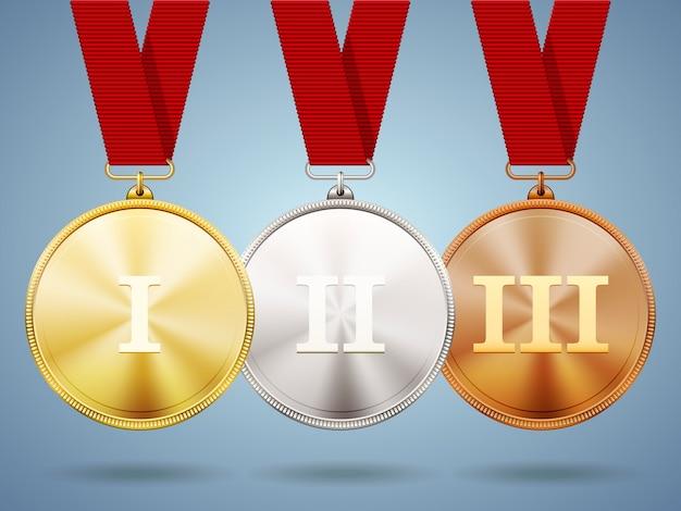 Medallas de oro, plata y bronce en cintas con superficies metálicas brillantes y números romanos para uno, dos y tres para ganar y colocar en un concurso de competencia deportiva o desafío empresarial