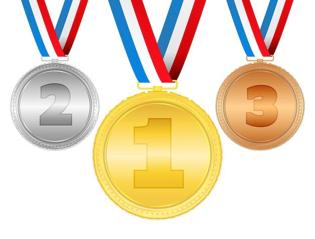 Medallas de oro, plata y bronce con cintas.