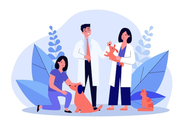 Médico veterinario y su asistente examinando perros y gatos