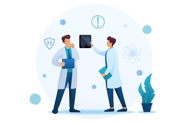 Los médicos jóvenes discuten los resultados del estudio del paciente.