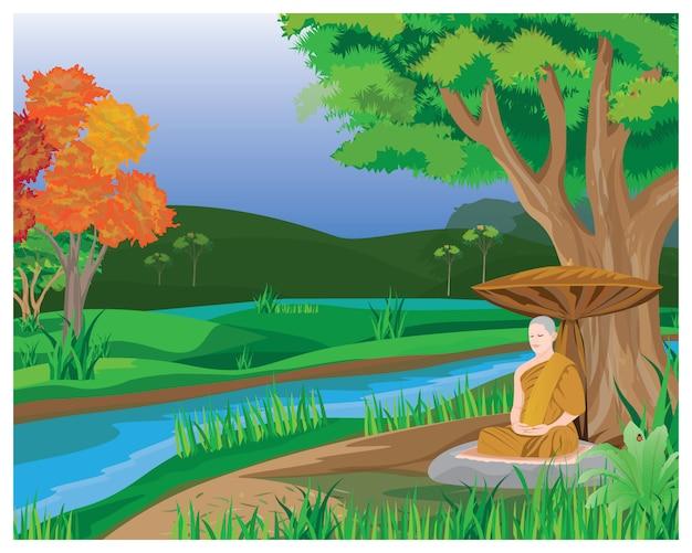 Meditación de un monje debajo del árbol en el bosque